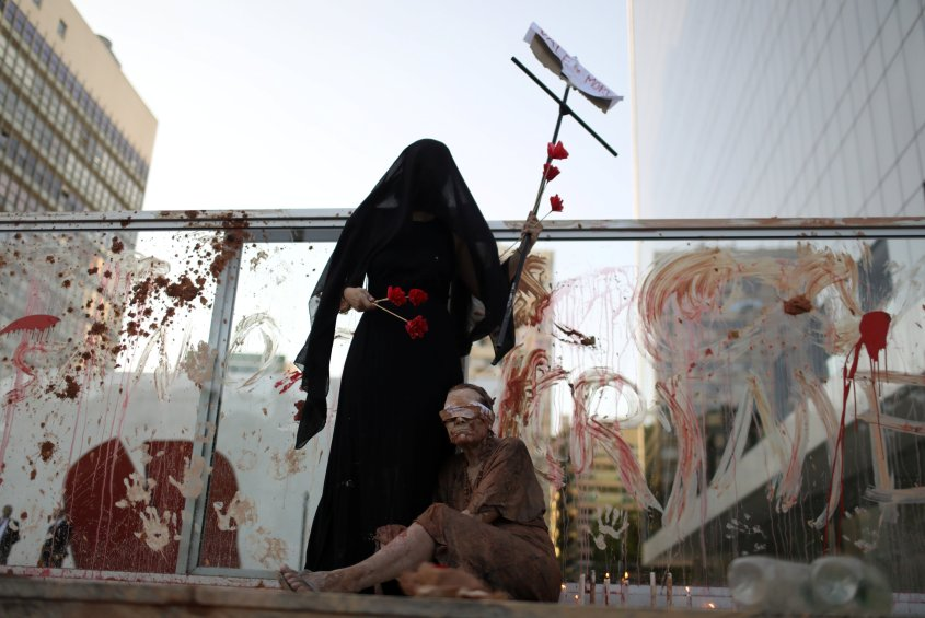 Activists attend a protest in front of the Brazilian mining company Vale SA headquarters in Rio de Janeiro