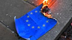 Pro-Brexit supporters burn an EU flag during a UKIP demonstration in central London